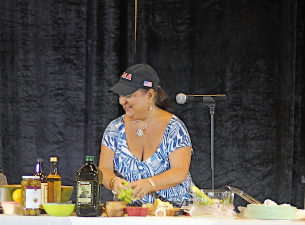 A woman doing a cooking demo.