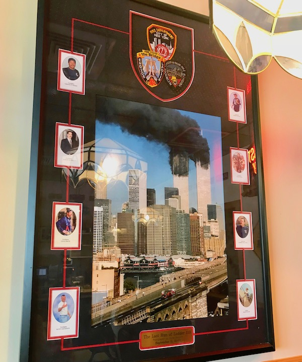 A framed photo of Photo of Twin Towers burning on 9/11