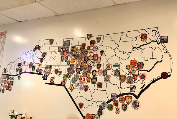Map of North Carolina with patches from visiting fire fighters