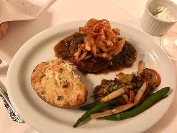 Filet of Beef with Fried Shallots on a white plate