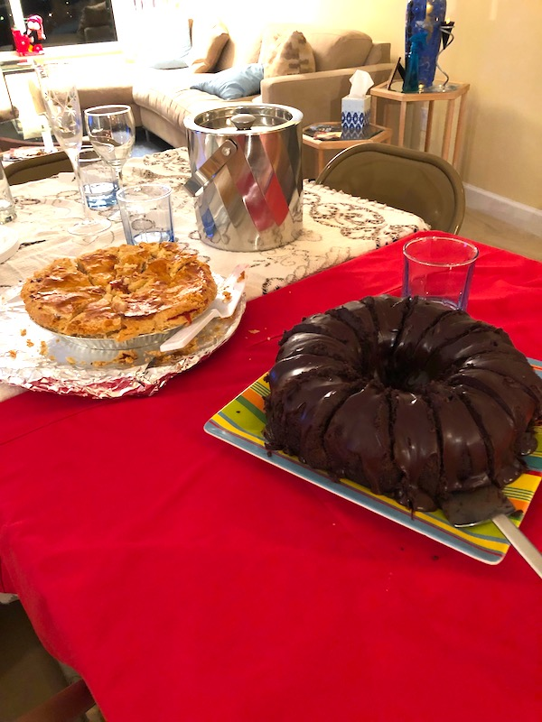 Platters of desserts on a dining room table