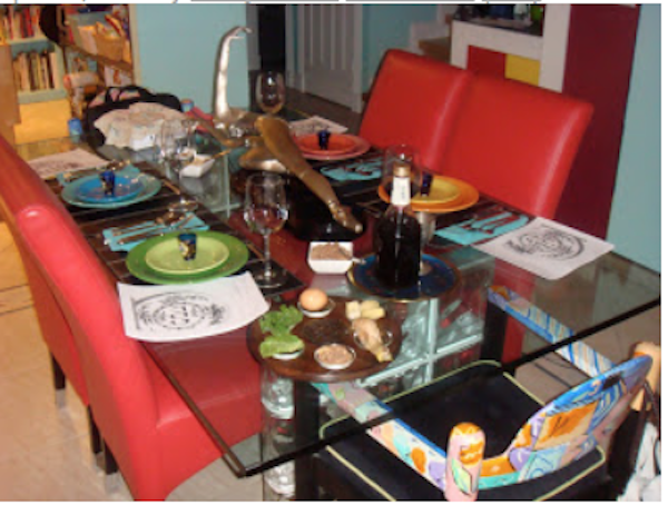 Glass topped dining table set for a Passover seder