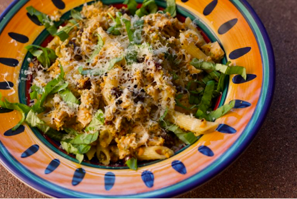 Penne with Tuna, Capers and Raisins in a yellow and blue rimmed pasta dish