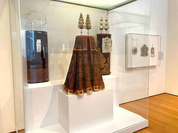 A variety of torahs on display in a museum
