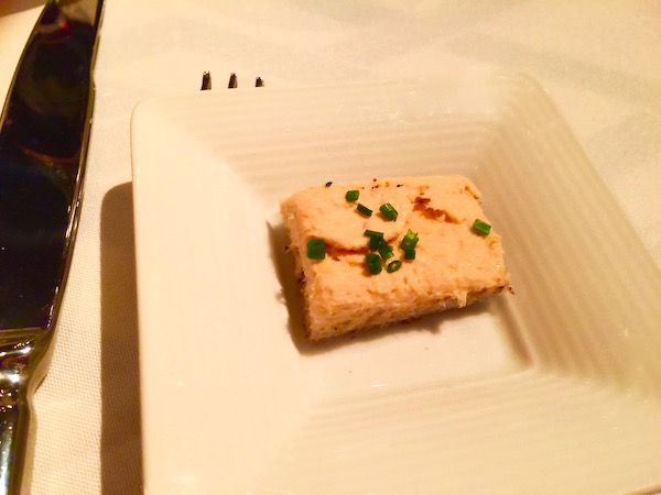 A square white plate with Smoked Trout Rillettes