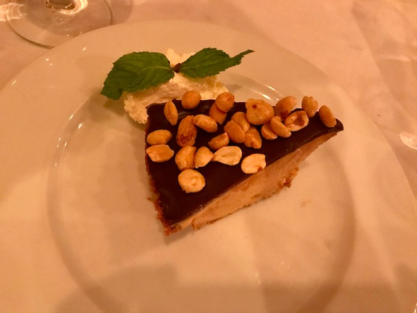 Chocolate Peanut Butter Pie  slice on a white plate