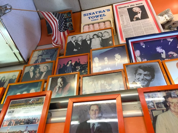 Celebrity Photos on a wall at White House Sub Shop