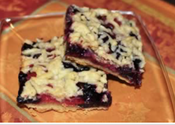 A square gold colored plate with two berry bars