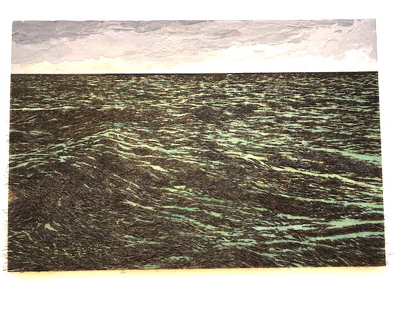 A mixed media piece of the sea done with paint and fishhooks.