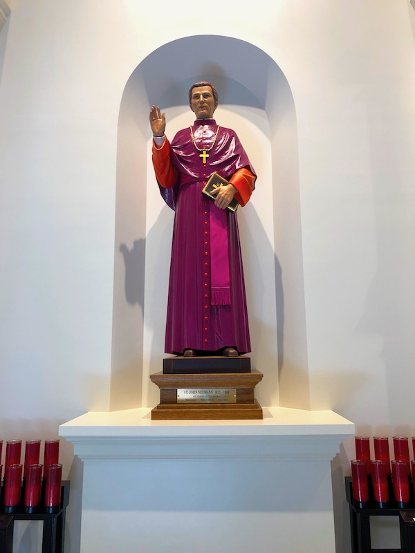 Statue of a Saint in red robes.