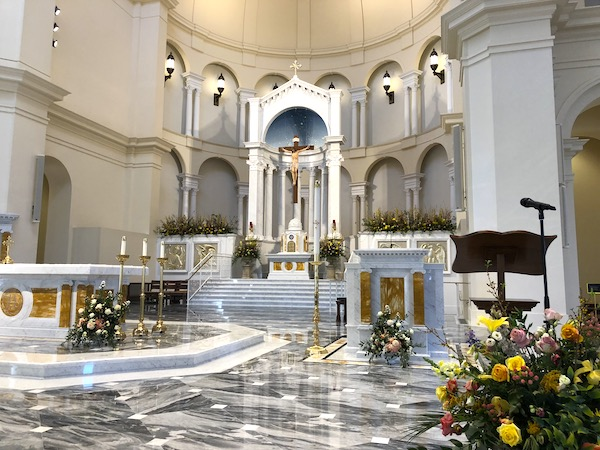 The alter of Holy Name of Jesus Cathedral in Raleigh NC with grey marble floor.