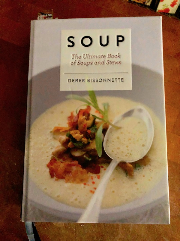 The front cover of a cookbook called Soup by Derek Bissonnette.