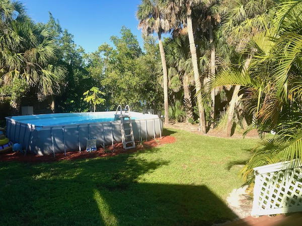 A very tropical landscape with an above ground pool at the Mellon Patch Inn on N. Hutchinson Island Florida.
