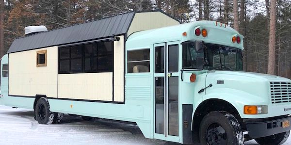 The Foodie Bus and The Help Bus is complete the bus is aqua and the barn section is white with a black roof.