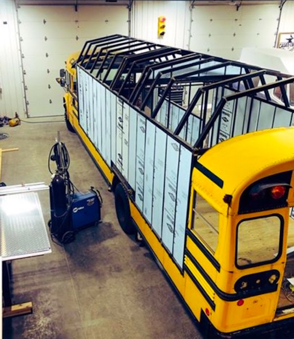 A yellow school bus being converted into The Foodie Bus and The Help Bus.