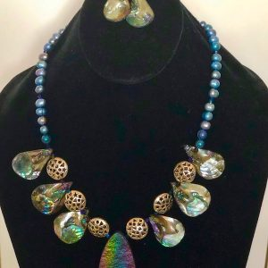 Abalone Freshwater Pearl and Pewter Necklace and Earrings on a black velvet display stand.