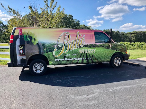A van that has wrapped graphics of Balić Winery in Mays Landing, New Jersey.