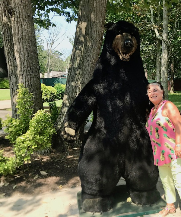 A woman with a large black bear statue at the Cape May County Zoo