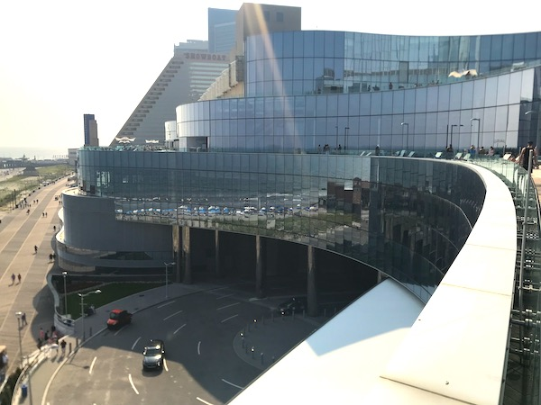 A huge hotel on the boardwalk with tons of glass is one of the Fun Things at the Jersey Shore.