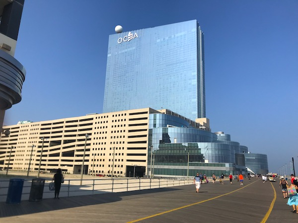A huge parking garage and glass hotel tower on the boardwalk is one of the Fun Things at the Jersey Shore.