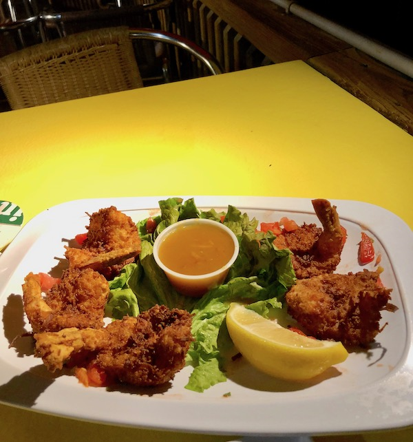 Harbor Cove Bar and Grill in Ft. Pierce Florida coconut shrimp appetizer with Grand Marnier sauce and lemon wedge.