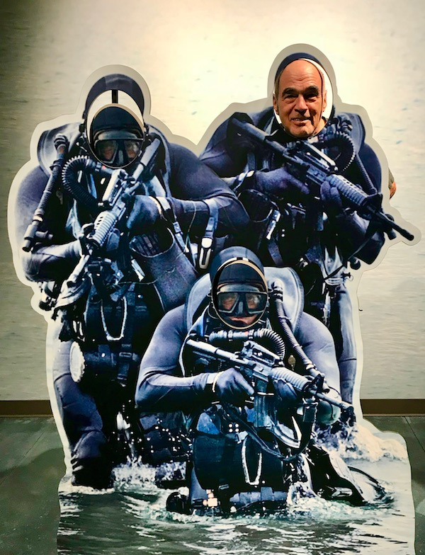 Navy Seal Museum on N. Hutchinson Island Florida a cardboard cutout of 3 Navy Seals with a man's face.