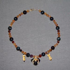 Onyx Swarovski Crystal and Glass Necklace on a gray background.