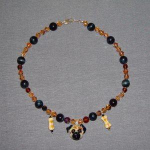 Onyx Swarovski Crystal and Glass Necklace on a gray background.