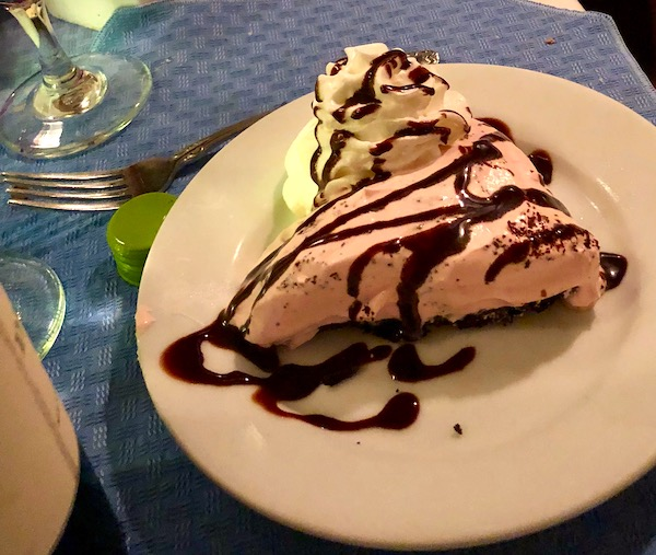 Chef Vola's in Atlantic City NJ Never Disappoints with a slice of chocolate chambord pie drizzled in chocolate and garnished with whipped cream.