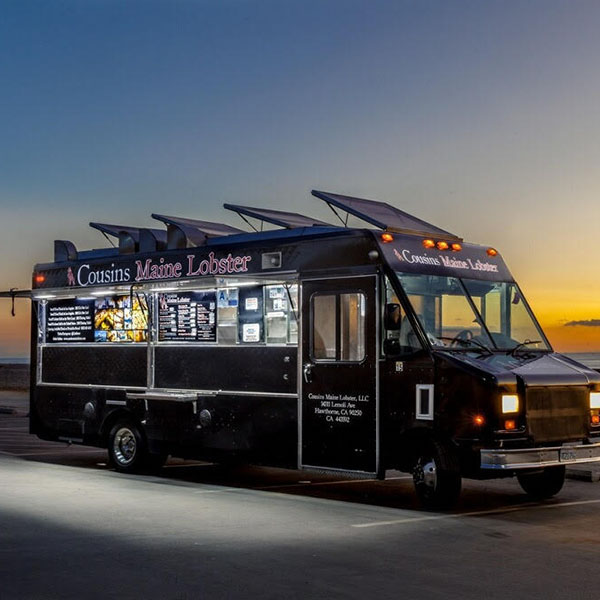 A black food truck with solar panels from Cousins Maine Lobster at the Morgan Street Food Hall.
