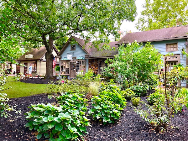 Lovely landscaping with quaint shops in the background at Historic Smithville NJ.