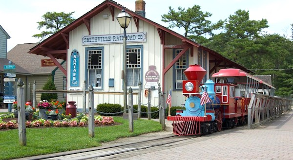 A colorful train and depot at Historic Smithville NJ.