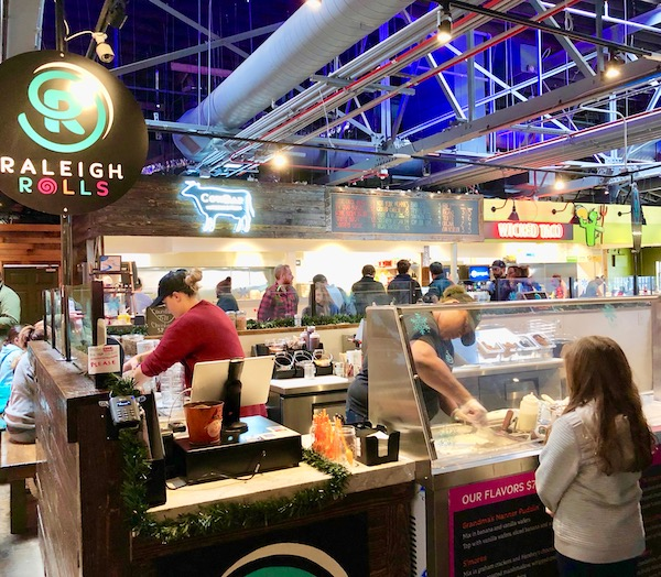 Food stores and tables inside including Makus Empanadas at the Morgan Street Food Hall.