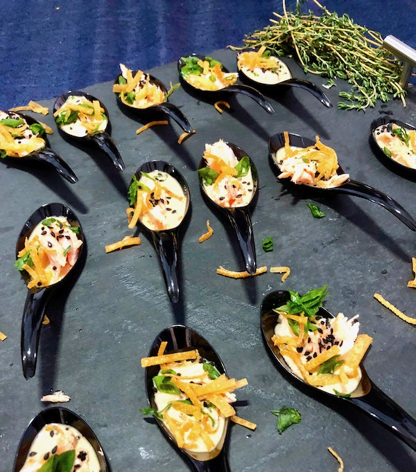 Black tasting spoons filled with salmon chowder at the 2019 Flavors Wellington Food and Wine Festival
