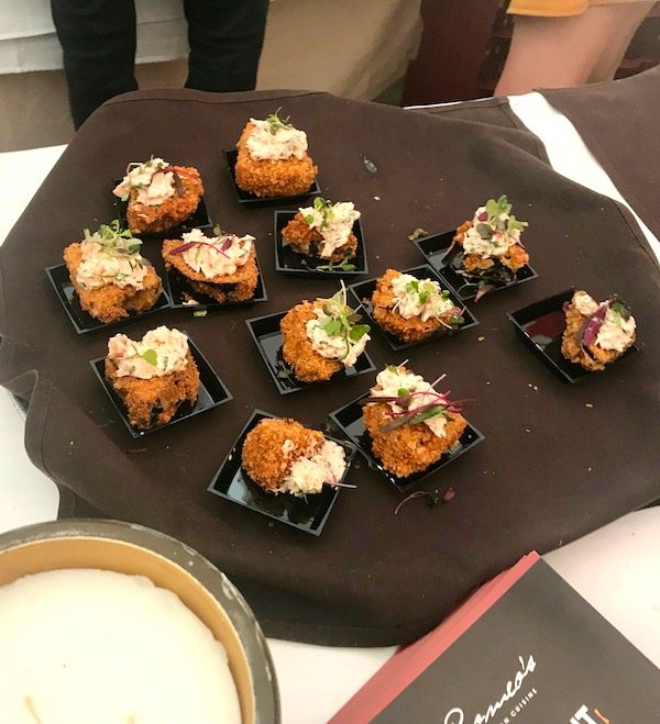 Fritters on a black cloth lined tray at the 2019 Flavors Wellington Food and Wine Festival