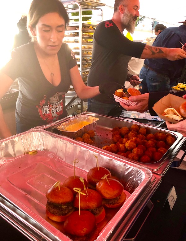 Hotel pans filled with sliders and little mac and cheese fritters at the 2019 Flavors Wellington Food and Wine Festival