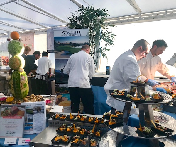 Chef refill food at the 2019 Flavors Wellington Food and Wine Festival