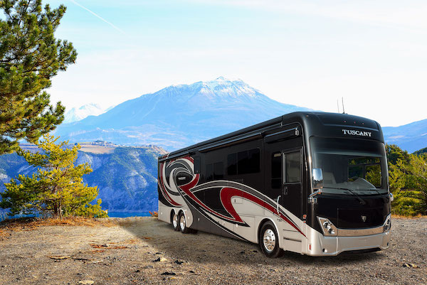 A Black And Tan Cl Hybrid Electric Rv With Mountain In Background