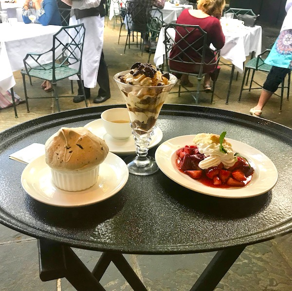 A waiters tray holding three desserts at Jazz Brunch at Commander's Palace