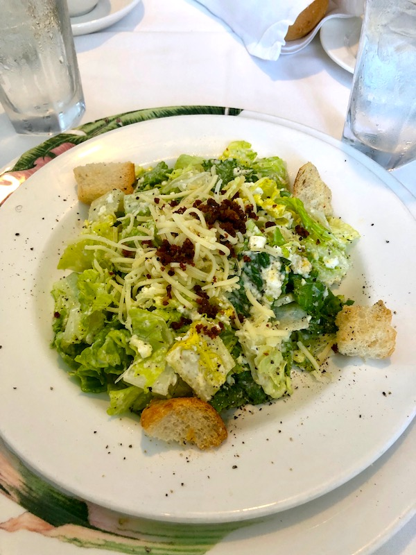 A salad of chopped romaine, croutons, bacon and shredded cheese at our Jazz Brunch at Commander's Palace