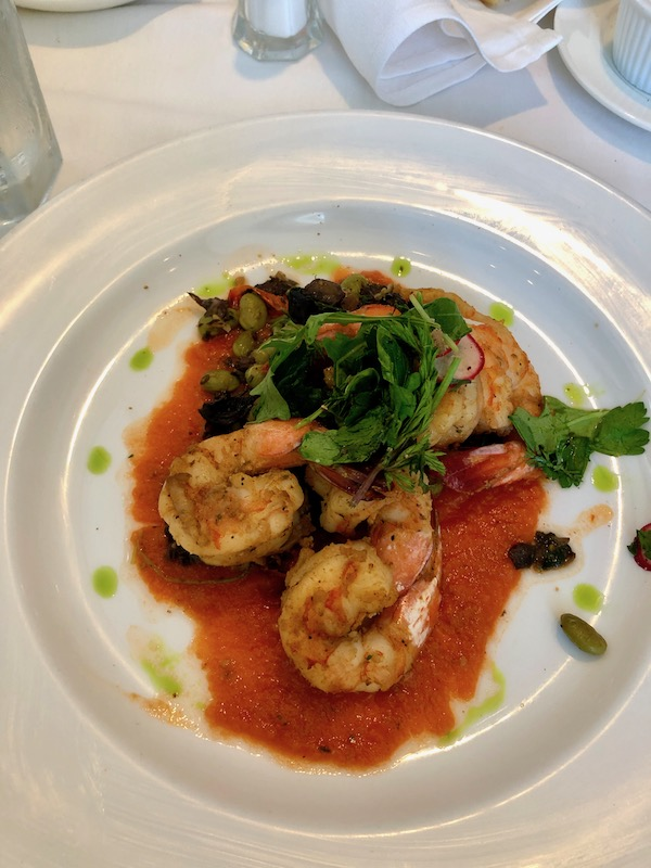 A plate of shrimp, herbs and tomatoes at our Jazz Brunch at Commander's Palace
