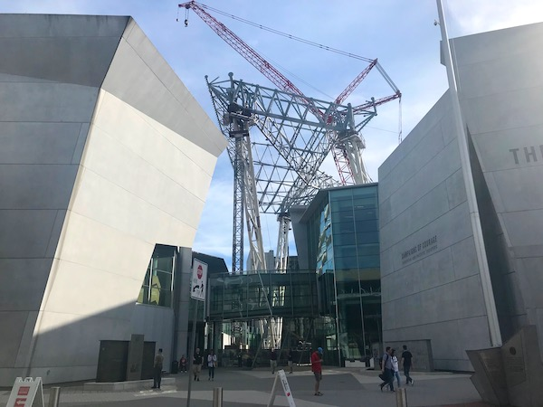 Two buildings with construction cranes in the middle at the National World War II Museum