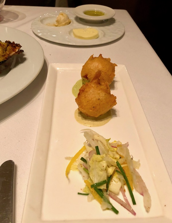 Crab fritters with pickled veg and sauce at Restaurant R'evolution NOLA