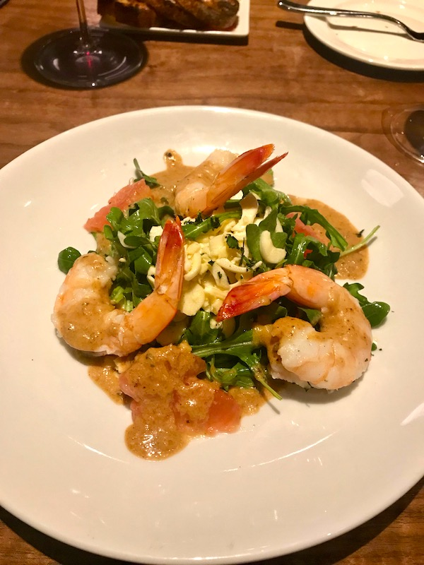 A plate of salad with shrimp, grapefruit segments and hearts of palm at Zasu Restaurant in Mid City New Orleans