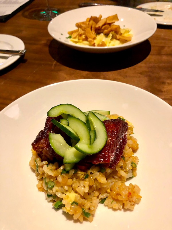 A plate of fried rice topped with short ribs and cucumber crescents at Zasu Restaurant in Mid City New Orleans