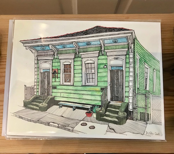 A print of a pale green shotgun home from Our Perfect Day in New Orleans